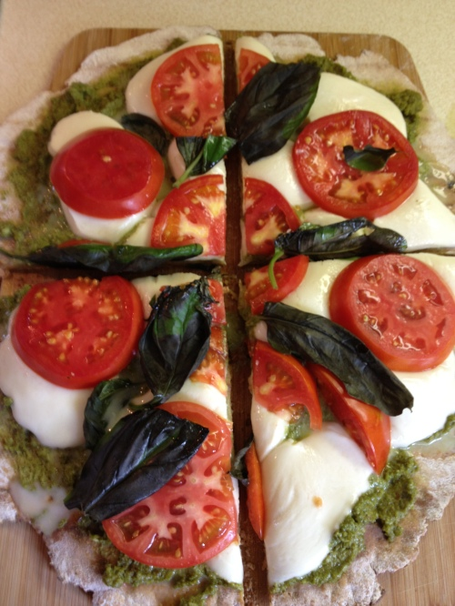 Sliced Grilled Caprese Pesto Pizza